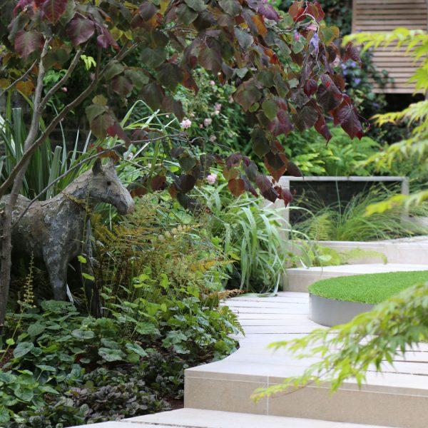 Contemporary Curves Garden in Camden, London - stone horse garden statue