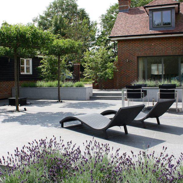 Contemporary Garden in Redbourn - patio area with deckchairs